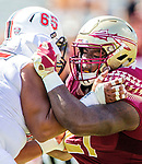 Florida State defensive tackle Marvin Wilson battles Northern Illinois University at the line of scrimmage on September 22, 2018 in Tallahassee, Florida.  The Seminoles defeated the Huskies 37-19.