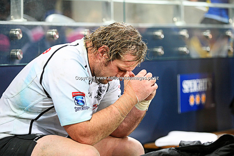 Sharks Jannie du Plessis dejected after losing to the Highlanders  in the Super Rugby match, Forsyth Barr Stadium, Dunedin, New Zealand, Saturday, May 05, 2013. Credit:NINZ/Dianne Manson