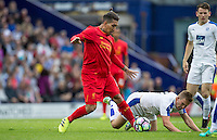 Roberto Firmino of Liverpool battles through during the 2016/17 Pre Season Friendly match between Tranmere Rovers and Liverpool at Prenton Park, Birkenhead, England on 8 July 2016. Photo by PRiME Media Images.