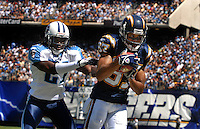 Sept. 17, 2006; San Diego, CA, USA; San Diego Chargers wide receiver (87) Keenan McCardell is pushed out of bounds by Tennessee Titans cornerback (21) Reynaldo Hill at Qualcomm Stadium in San Diego, CA. Mandatory Credit: Mark J. Rebilas