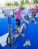 12 JUL 2014 - HAMBURG, GER - Vicky Holland (GBR) from Great Britain prepares in transition for the start of the elite women's 2014 ITU World Triathlon Series round in the Altstadt Quarter, Hamburg, Germany (PHOTO COPYRIGHT © 2014 NIGEL FARROW, ALL RIGHTS RESERVED)