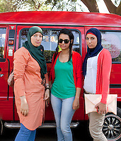 Mohra, Nada and Shrouk stand in front of a car in the campus of Ain Shams University in Cairo, where they are studying psychology, art and law. Cairo, Egypt. October 9th, 2012.<br /> (assignment for the Financial Times)