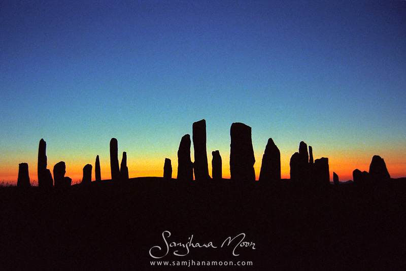&quot;One of the most spectacular megalithic monuments in Scotland and a personal favourite in the British Isles. We chased the sunset west hitching a ride across the island with a local, I ran up the hill to get this stunning shot.&quot;<br /> Shot on 35mm film and digitally re-mastered for optimum effect. Some analogue film texture can be seen in print which adds to the beauty of the image.<br /> The Callanish Stones are a unique setting of standing stones erected around 2000 BC that form the shape of a Celtic cross. The centre circle contains the tallest of all (4.75m/15 ft 6 in) with three single rows of stones to the east, south and west, and a double row to the north. An aerial view reveals it's shape of the Celtic cross.