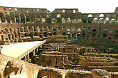 Rome, Italy - April 2, 2006 -- Interior view of The Colosseum in Rome, Italy on Sunday, April 2, 2006.  It was commissioned by the Roman Emperor Vespasian in AD 72 and was completed in AD 80.  It is considered as Rome's greatest amphitheatre. Deadly gladiatorial combats and wild animal fights were staged there by emperors and wealthy citizens.  It had a capacity of 55,000 people.  The platform at left was built recently for events such as rock concerts.  It is built where the original arena floor existed.  The ruins underneath were where the wild animals and gladiators were kept before their combat in the arena..Credit: Ron Sachs / CNP
