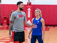 HOUSTON, TX - FEBRUARY 1: Austin Rivers of the Houston Rockets talks with Julie Ertz #8 of the United States at Houston Rockets Training Center on February 1, 2020 in Houston, Texas.