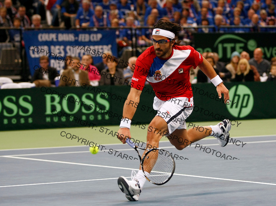 Serbian Davis Cup team player Janko Tipsarevic returns the ball during first match of the Davis Cup finals Serbia vs France against Gael Monfils in Belgrade Arena in Belgrade, Serbia, Friday, 3. December 2010.(foto: Srdjan Stevanovic/Starsportphoto ©)