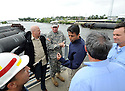 Louisiana Governor Bobby Jindal, center, speaks to (left to right) Army Corps of Engineers Canal Captain Ray Newman, New Orleans Mayor Mitch Landrieu, Army Corps of Engineers Colonel Ed Fleming , U.S. Senator David Vitter and Jefferson Parish President John Young while touring the new levee wall and pumps at the 17th Street Canal, built after Hurricane Katrina,  as Hurricane Isaac approaches New Orleans, Tuesday, Aug. 28, 2012. The Category 1 hurricane is expected to hit New Orleans overnight....(AP Photo/Cheryl Gerber)