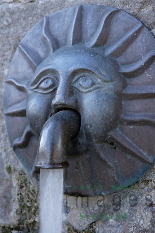 Face of the sun with fresh water coming out of it at the Tolbooth Arts Centre Kirkcudbright Scotland UK