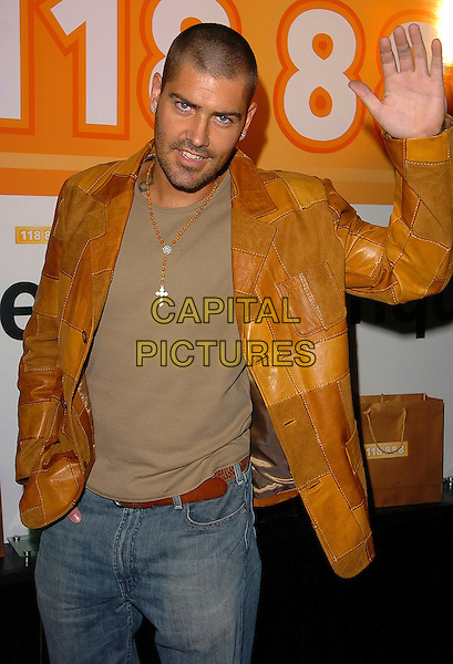 SHANE LYNCH.118 888 New Campaign Launch Party at Trap, 201 Wardour Street, London, W1..August 1st, 2005.half length brown patch leather jacket cross crucifix waving hand palm gesture.www.capitalpictures.com.sales@capitalpictures.com.©Capital Pictures