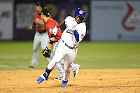 Chattanooga Lookouts second baseman Darnell Sweeney (9) runs the bases during a game against the Birmingham Barons on April 24, 2014 at AT&T Field in Chattanooga, Tennessee.  Chattanooga defeated Birmingham 5-4.  (Mike Janes/Four Seam Images)
