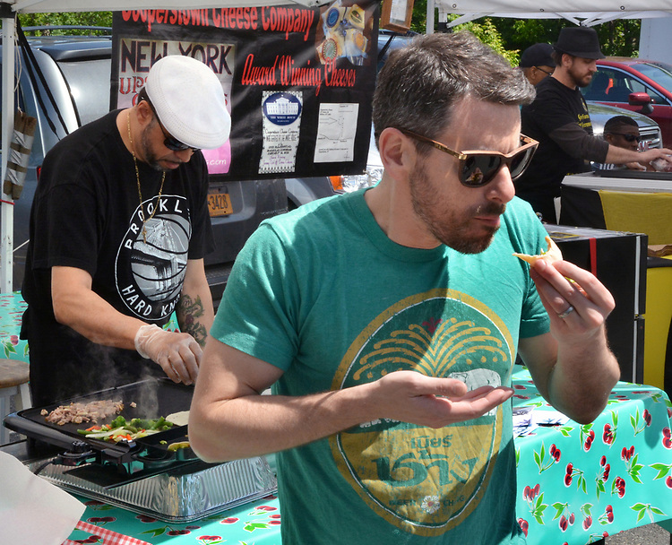Bobby Bruno, Owner-Chef of Cafe Deli-cioso, at his booth, where he gave a cooking demonstration, at the Opening Day of the 2017 Saugerties Farmer's Market on Saturday, May 27, 2017. Photo by Jim Peppler. Copyright/Jim Peppler-2017.