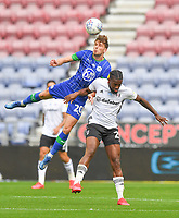 Wigan Athletic's Joe Williams battles with Fulham's Joshua Onomah<br /> <br /> Photographer Dave Howarth/CameraSport<br /> <br /> The EFL Sky Bet Championship - Wigan Athletic v Fulham - Wednesday July 22nd 2020 - DW Stadium - Wigan<br /> <br /> World Copyright © 2020 CameraSport. All rights reserved. 43 Linden Ave. Countesthorpe. Leicester. England. LE8 5PG - Tel: +44 (0) 116 277 4147 - admin@camerasport.com - www.camerasport.com