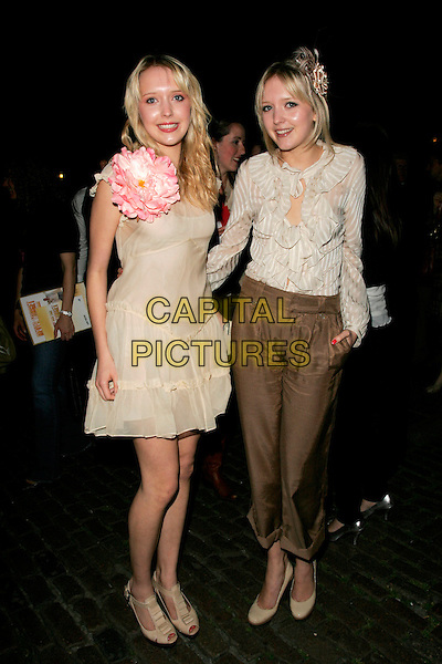 SAMANTHA & AMANDA MARCHANT.The Never Forget Take That Musical - West End Transfer - gala night, afterparty, Covent Garden, London, England..May 22nd, 2008.after party full length sam samanda twins sisters siblings family white cream beige dress pink large giant corsage flower blouse ruffled ruffles brown trousers .CAP/AH.©Adam Houghton/Capital Pictures.