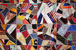 Antique quilt colorful with stitching of patchwork for background