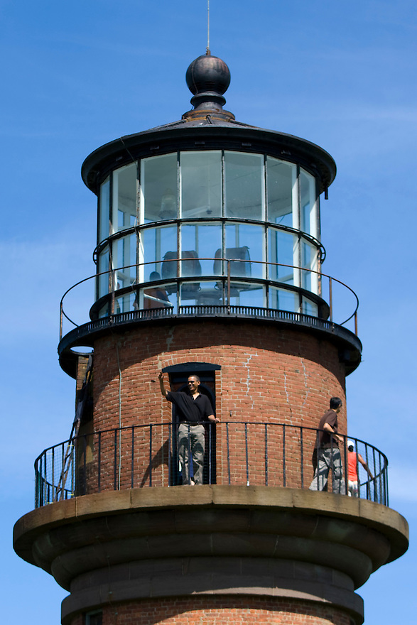 U.S. President Barack Obama waves from the Gay Head Lighthouse during a vacation tour with his family (not pictured) in Aquinnah on Martha's Vineyard.  The lighthouse began operating in 1799. ......................
