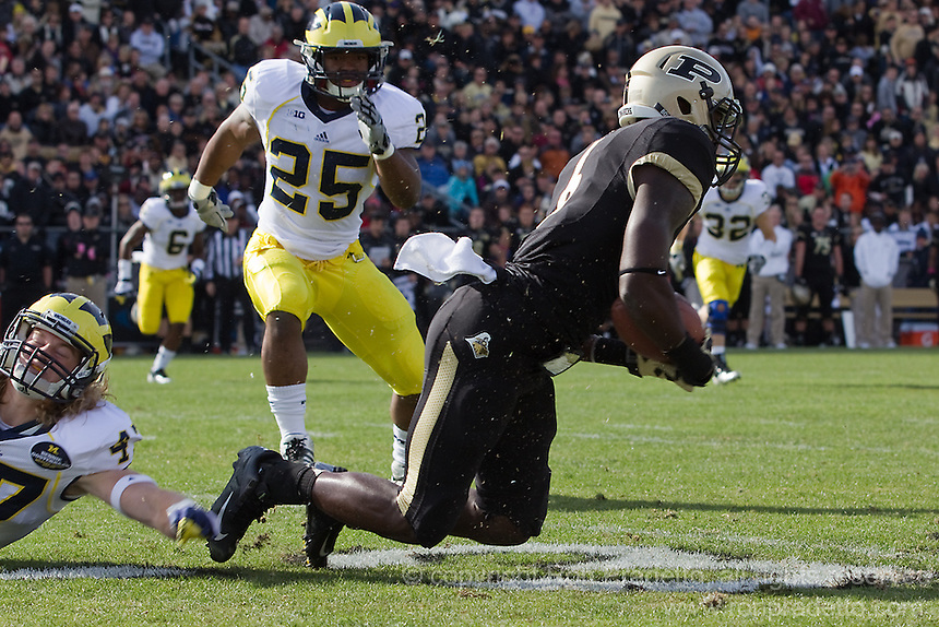 Michigan linebacker Jake Ryan tackles Purdue wide receiver Gary Bush as linebacker Kenny Demens (25) looks on. The Michigan Wolverines defeated the Purdue Boilermakers 44-13 on October 6, 2012 at Ross-Ade Stadium in West Lafayette, Indiana.