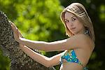 A beautiful young woman wearing a bikini at Cadboro Bay Beach in Victoria, British Columbia, BC, Canada.