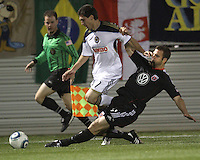 Daniel Woolard(21) of D.C. United slides the ball away from Levi Houapeu(11) of the Philadelphia Union during a play-in game for the US Open Cup tournament at Maryland Sportsplex, in Boyds, Maryland on April 6 2011. D.C. United won 3-2 after overtime penalty kicks.