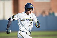 Michigan Wolverines first baseman Jake Bivens (18) runs to first base against the Central Michigan Chippewas on May 9, 2017 at Ray Fisher Stadium in Ann Arbor, Michigan. Michigan defeated Central Michigan 4-2. (Andrew Woolley/Four Seam Images)