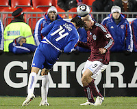 George John#14 of FC Dallas clashes heads with Conor Casey#9 of the Colorado Rapids during MLS Cup 2010 at BMO Stadium in Toronto, Ontario on November 21 2010.Colorado won 2-1 in overtime.