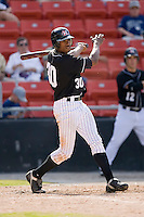 Center fielder Marcus Davis (30) of the Hickory Crawdads follows through on his swing versus the Charleston RiverDogs at L.P. Frans Stadium in Hickory, NC, Sunday, May 4, 2008.