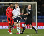 The referee steps in between Daniel Sturridge of Liverpool and Josh Vela of Bolton Wanderers - FA Cup Fourth Round replay - Bolton Wanderers vs Liverpool - Macron Stadium  - Bolton - England - 4th February 2015 - Picture Simon Bellis/Sportimage