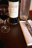 Tradition Chateau Chenaie Faugeres, 2002 on a restaurant table. Faugeres. Languedoc. France. Europe. Bottle.