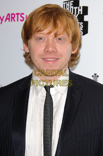 RUPERT GRINT .Attending the South Bank Sky Arts Awards, The Dorchester Hotel, London, England, UK, 25th January 2011..portrait headshot black tie white shirt smiling .CAP/CJ.©Chris Joseph/Capital Pictures.