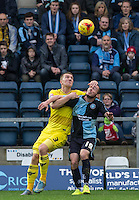 Joe Skarz of Oxford United battles Michael Harriman of Wycombe Wanderers during the Sky Bet League 2 match between Wycombe Wanderers and Oxford United at Adams Park, High Wycombe, England on 19 December 2015. Photo by Andy Rowland.