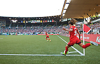 Portland, Oregon - Saturday July 2, 2016: Portland Thorns FC forward Nadia Nadim (9) takes a corner kick during a regular season National Women's Soccer League (NWSL) match at Providence Park.
