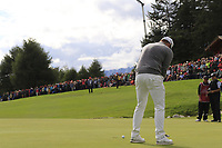 Tyrrell Hatton (ENG) putts on the 18th green during Sunday's Final Round of the 2017 Omega European Masters held at Golf Club Crans-Sur-Sierre, Crans Montana, Switzerland. 10th September 2017.<br /> Picture: Eoin Clarke | Golffile<br /> <br /> <br /> All photos usage must carry mandatory copyright credit (&copy; Golffile | Eoin Clarke)