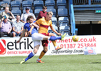 Darren Brownlie gets a foot to the ball before James Scott in the SPFL Betfred League Cup group match between Queen of the South and Motherwell at Palmerston Park, Dumfries on 13.7.19.