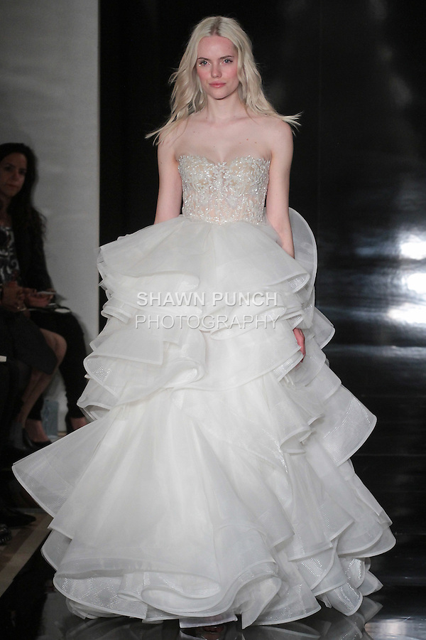 Model walks runway in an organza layered ball gown with embroidered illusion bodice from the Reem Acra Spring 2017 bridal collection, during New York Bridal Fashion Week Spring Summer 2017, on April 15, 2016.