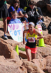 August 15, 2015 - Manitou Springs, Colorado, U.S. - Evergreen, Colorado runner, Brandy Erholtz, is encouraged by a young running fan as she works her way through the final steep and rocky pitch on her way to a 2nd place finish in a time of 2:51:38 during the 60th running of the Pikes Peak Ascent.  During the Ascent, runners cover 13.3 miles and gain more than 7815 feet (2382m) by the time they reach the 14,115ft (4302m) summit.  On the second day of race weekend, 800 marathoners will make the round trip and cover 26.6 miles of high altitude and very difficult terrain in Pike National Forest, Manitou Springs, CO.