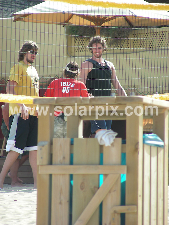 **ALL ROUND PICTURES FROM SOLARPIX.COM**.**WORLDWIDE SYNDICATION RIGHTS EXCLUDING SPAIN - NO PUBLICATION IN SPAIN**.NFL Basketball champion Paul Gasol relaxes today with friends on the beach in Ibiza Spain..JOB REF: 4090         MAD       DATE: 18.06.07.**MUST CREDIT SOLARPIX.COM OR DOUBLE FEE WILL BE CHARGED* *UNDER NO CIRCUMSTANCES IS THIS IMAGE TO BE REPRODUCED FOR ANY ONLINE EDITION WITHOUT PRIOR PERMISSION*