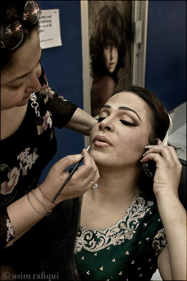 Ali Saleem a.k.a Begum Nawazish, a popular cross-dressing tv talk show host has his make up done before heading to the studios to record a women's day special with human rights activist asma jehangir and educationist salima hashmi