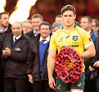 Australia's Michael Hooper holding a poppy wreath at the start of the game<br /> <br /> Photographer Simon King/CameraSport<br /> <br /> International Rugby Union - 2017 Under Armour Series Autumn Internationals - Wales v Australia - Saturday 11th November 2017 - Principality Stadium - Cardiff<br /> <br /> World Copyright &copy; 2017 CameraSport. All rights reserved. 43 Linden Ave. Countesthorpe. Leicester. England. LE8 5PG - Tel: +44 (0) 116 277 4147 - admin@camerasport.com - www.camerasport.com