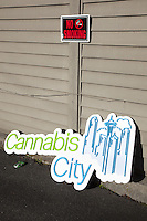 USA. Washington state. Seattle. A no smoking sign at Cannabis City. Cannabis City is authorized, according to cannabis legalization in Washington State, to sell marijuana as a retail store front. Cannabis City was the first state-licensed store for recreational marijuana open in July 2014. Cannabis, commonly known as marijuana, is a preparation of the Cannabis plant intended for use as a psychoactive drug and as medicine. Pharmacologically, the principal psychoactive constituent of cannabis is tetrahydrocannabinol (THC); it is one of 483 known compounds in the plant, including at least 84 other cannabinoids, such as cannabidiol (CBD), cannabinol (CBN), tetrahydrocannabivarin (THCV), and cannabigerol (CBG). 14.12.2014 © 2014 Didier Ruef