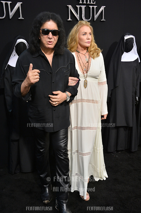 """LOS ANGELES, CA. September 04, 2018: Gene Simmons & Shannon Tweed at the world premiere of """"The Nun"""" at the TCL Chinese Theatre, Hollywood."""