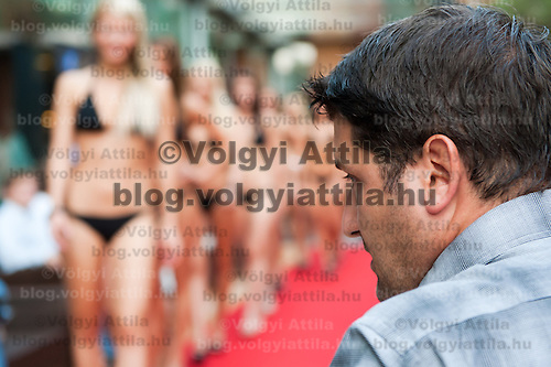 Peter Hajdu judges girls during the preliminary contest for the most prestigious beauty pageants Miss World Hungary, Miss Universe Hungary and Miss Earth Hungary held in Hotel Abacus, Herceghalom, Hungary on July 07, 2011. ATTILA VOLGYI