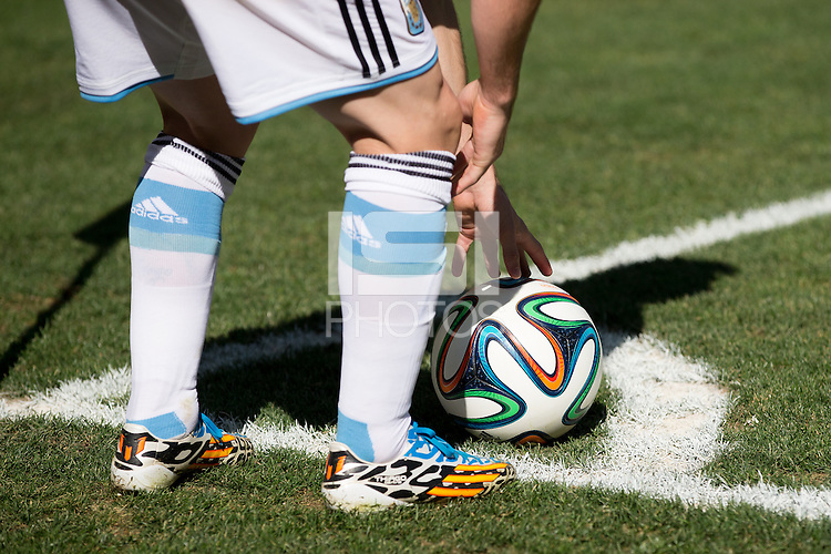 Lionel Messi of Argentina places the ball on the corner spot