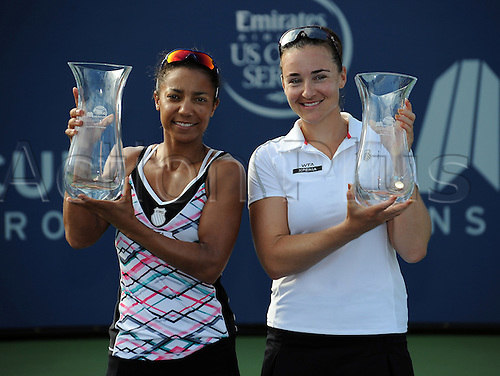 22.07.2012. La Costa, California, USA.  Raquel Kops-Jones (USA) and doubles partner Abigail Spears (USA) with their trophies after defeating Vania King (USA) and Nadia Petrova (RUS) in a doubles final to win the Mercury Insurance Open played at the La Costa Resort and Spa.