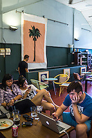 Customers enjoy a drink and browse in DR.inc  cafe and Nala Designs in Bangsar, Kuala Lumpur, Malaysia, on 18 August 2015. Nala Designs, by founder and designer Lisette Scheers, is inspired by Malaysia's melting pot of Chinese, Malay and Indian cultures. Photo by Suzanne Lee for Monocle