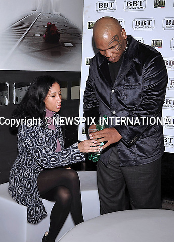 "MIKE TYSON  AND WIFE LAKIHA SPICER.at the Discoteca ""Disco Festival"", Viterbo, Italy_22/10/2009.Mandatory Credit Photo: ©NEWSPIX INTERNATIONAL..**ALL FEES PAYABLE TO: ""NEWSPIX INTERNATIONAL""**..IMMEDIATE CONFIRMATION OF USAGE REQUIRED:.Newspix International, 31 Chinnery Hill, Bishop's Stortford, ENGLAND CM23 3PS.Tel:+441279 324672  ; Fax: +441279656877.Mobile:  07775681153.e-mail: info@newspixinternational.co.uk"