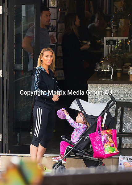 30 SEPTEMBER 2015 SYDNEY AUSTRALIA<br /> <br /> EXCLUSIVE PICTURES<br /> <br /> Beau Ryan pictured with his very understanding wife Kara and their daughter, talking a walk together for the first time since news of his affair with Lauren Brant broke. <br /> <br /> Kara is also pictured the day before enjoying some time with friends in a park. She was snapped on her phone several times and taking selfies.