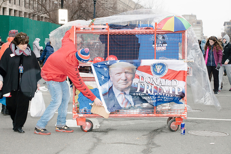 A street vendor sells Trump-themed memorabilia as people gather near the National Mall to watch the inauguration of President Donald Trump on Jan. 20, 2017, in Washington, D.C.