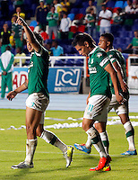 CALI - COLOMBIA -05 -03-2014: Robin Ramirez (Izq.) jugador de Deportivo Cali celebra el gol anotado al Atletico Huila, durante partido pendiente de la sexta fecha de la Liga Postobon I-2014, jugado en el estadio Pascual Guerrero de la ciudad de Cali. / Robin Ramirez (L) player  of Deportivo Cali celebrates a goal scored to Atletico Huila during a pending match for the sixth date of the Liga Postobon I-2014 at the Pascual Guerrero stadium in Cali city. Photo: VizzorImage  / Juan C Quintero / Str.