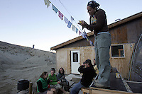 University of Toronto student Tracey Gray reads messages written on flags at White Mountain high altitude research station, Sept. 1 2006. The zoologist, along with around 20 other students from Canada are doing various research at White Mountain Peak high altitude research station, highest altitude research facility in North America on White Mountain, near Bishop, California. The research station is at 14,250 feet, just north of the Patriarch Grove area where ancient bristlecone pine trees grow. The station is operated by the University of California and used by astrophysicists, geologists, botanists and zoologists.