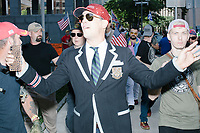 "Alt-right provocateur Milo Yiannopoulos walks with supporters after serving as Grand Marshall of the Straight Pride Parade in Boston, Massachusetts, on Sat., August 31, 2019. Yiannopoulos wore a sequined red hat in the style of Make America Great Again (MAGA) hats reading ""Make America Straight Again."" Yiannopoulos addressed the crowd with a short speech on arrival and then rode the ""Trump Unity Bridge"" float for the duration of the parade. Despite leading the Straight Pride Parade and singing along with patriotic American songs throughout the parade, Yiannopoulos is gay and is not an American citizen."