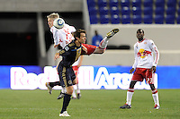 John Wolyniec (15) of the New York Red Bulls gets tangled with Stefani Miglioranzi (6) of the Philadelphia Union while going for a header. The New York Red Bulls defeated the Philadelphia Union 2-1 during a US Open Cup qualifier at Red Bull Arena in Harrison, NJ, on April 27, 2010.